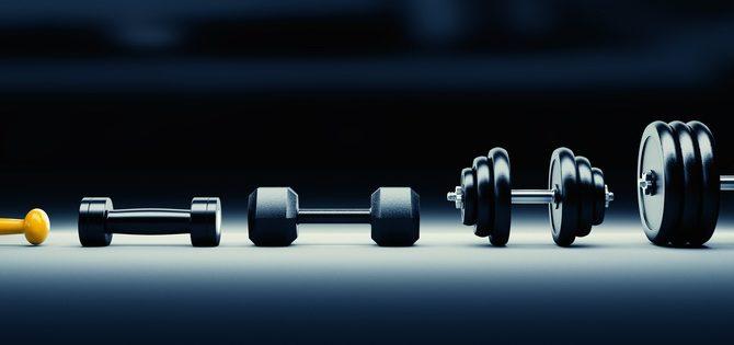 des poids de musculation en progression